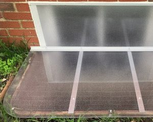 custom window well cover with extension on metal window well