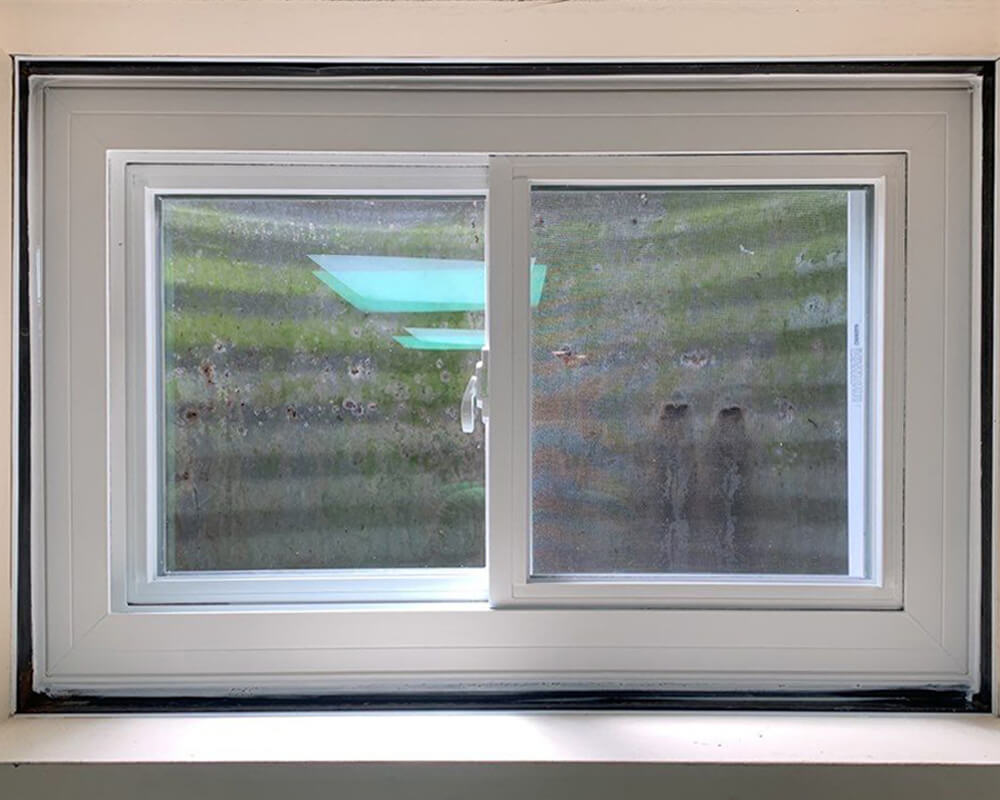 basement window replaced with new one