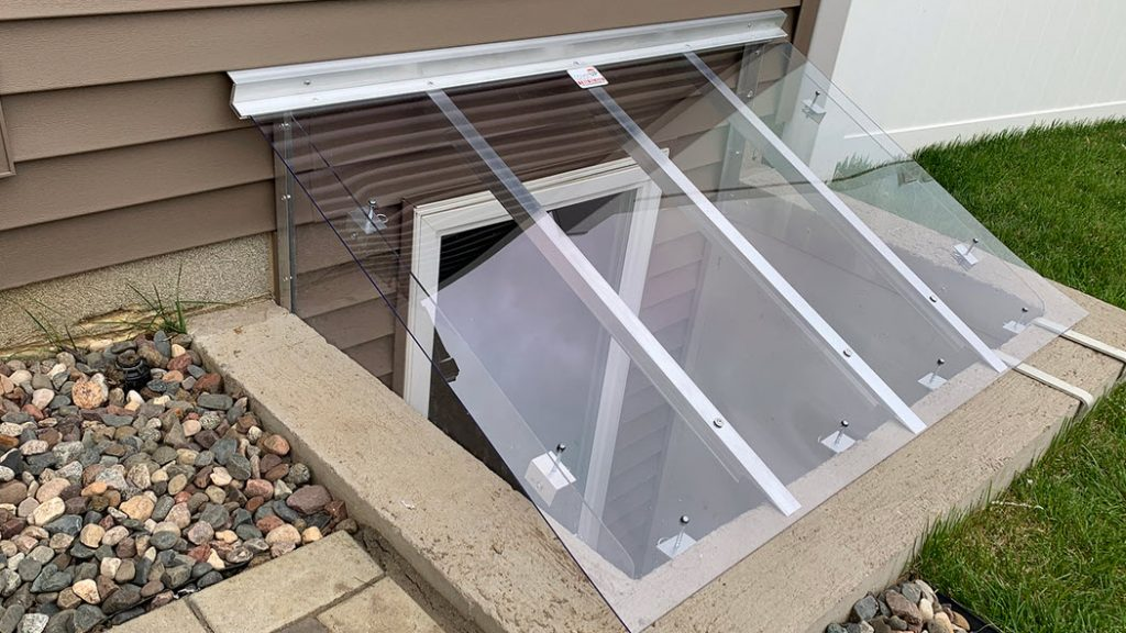 window well cover with an angled riser