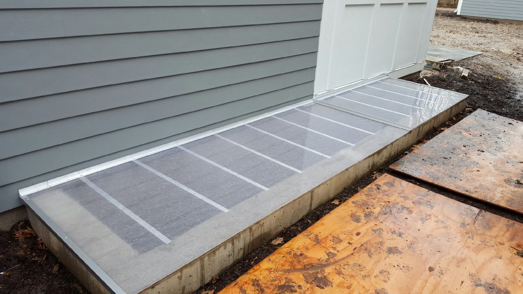 custom cover on large concrete window well