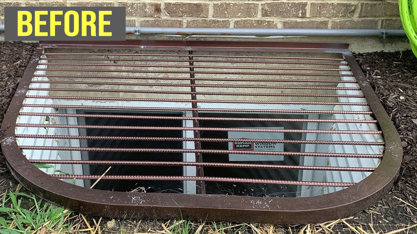 window well with steel grate cover