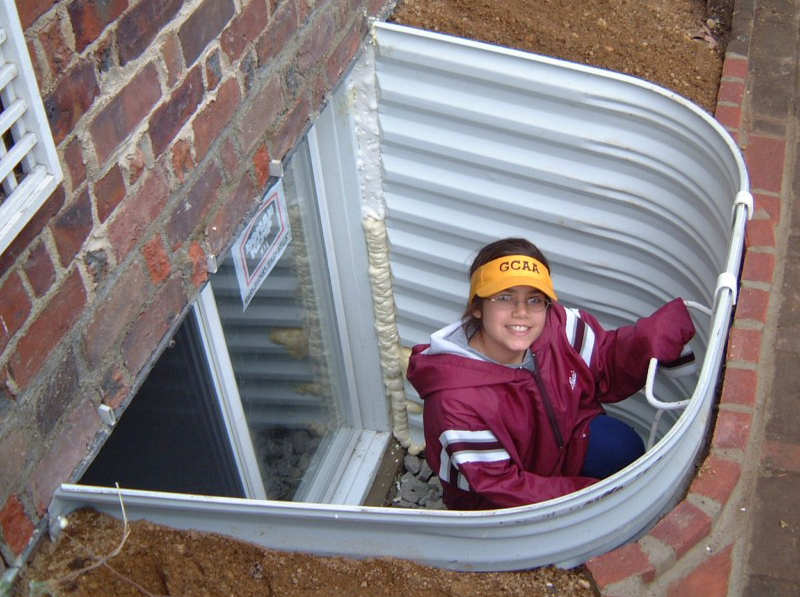 window well with safety ladder