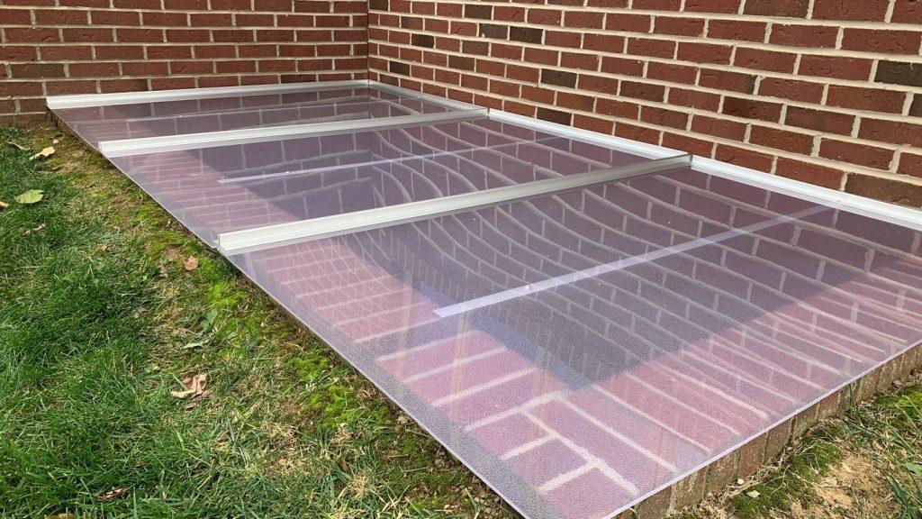 custom window well cover on large brick window well