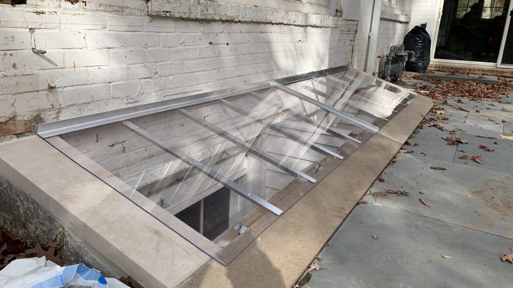 concrete window well with cover