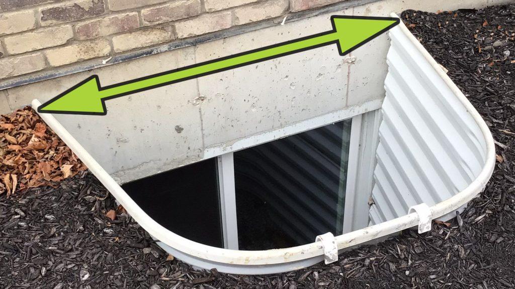 arrow showing how to measure width of window well