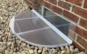 window well cover with a vertical extension